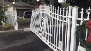 damaged white steel custom gate repaired
