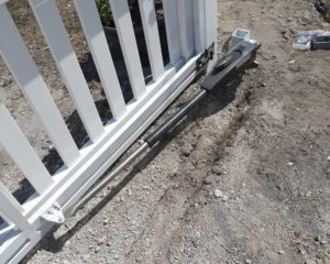 access control gate on white steel gate